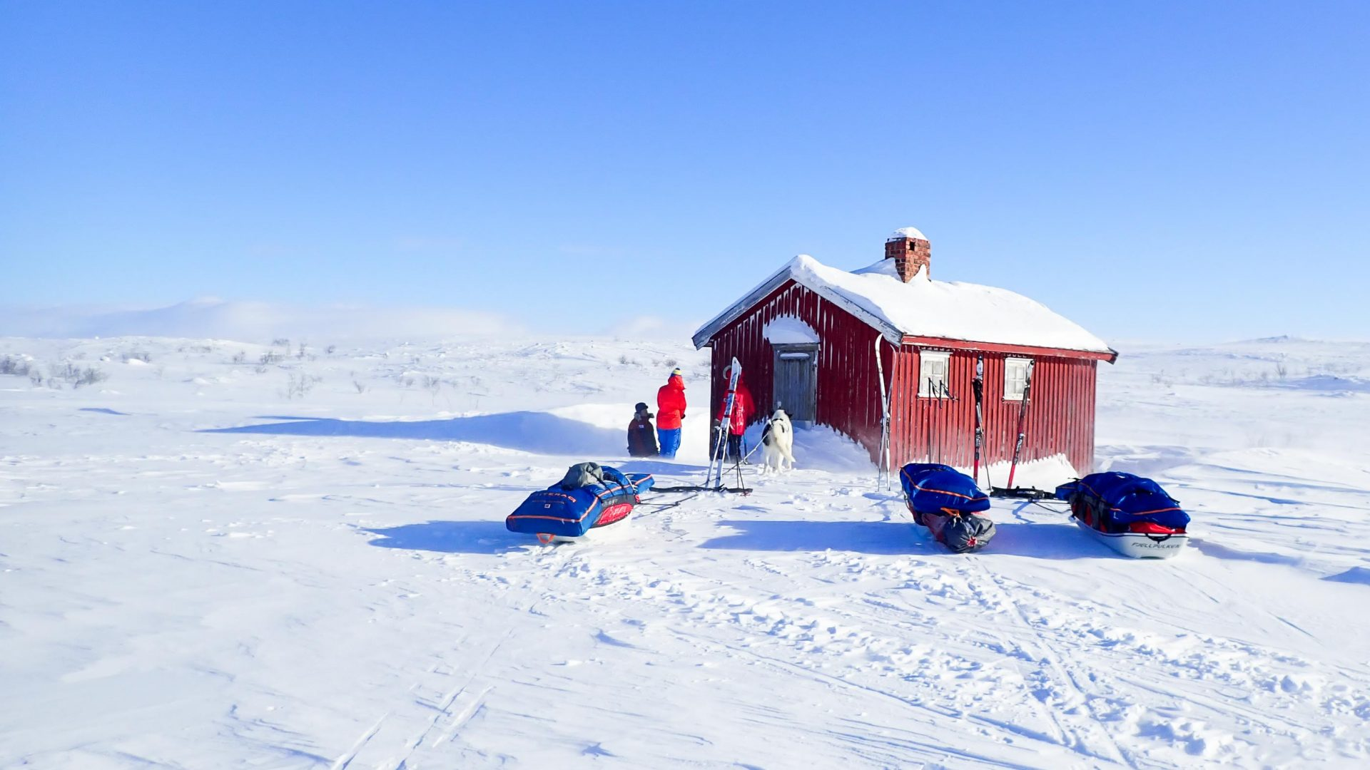 Red hut in snow.