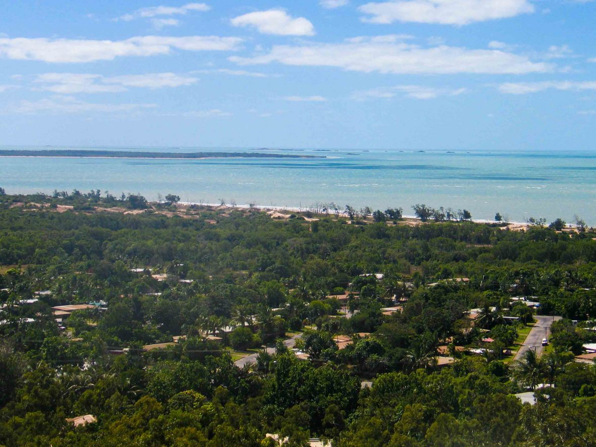 View over Nhulunbuy showing blue water and green trees.