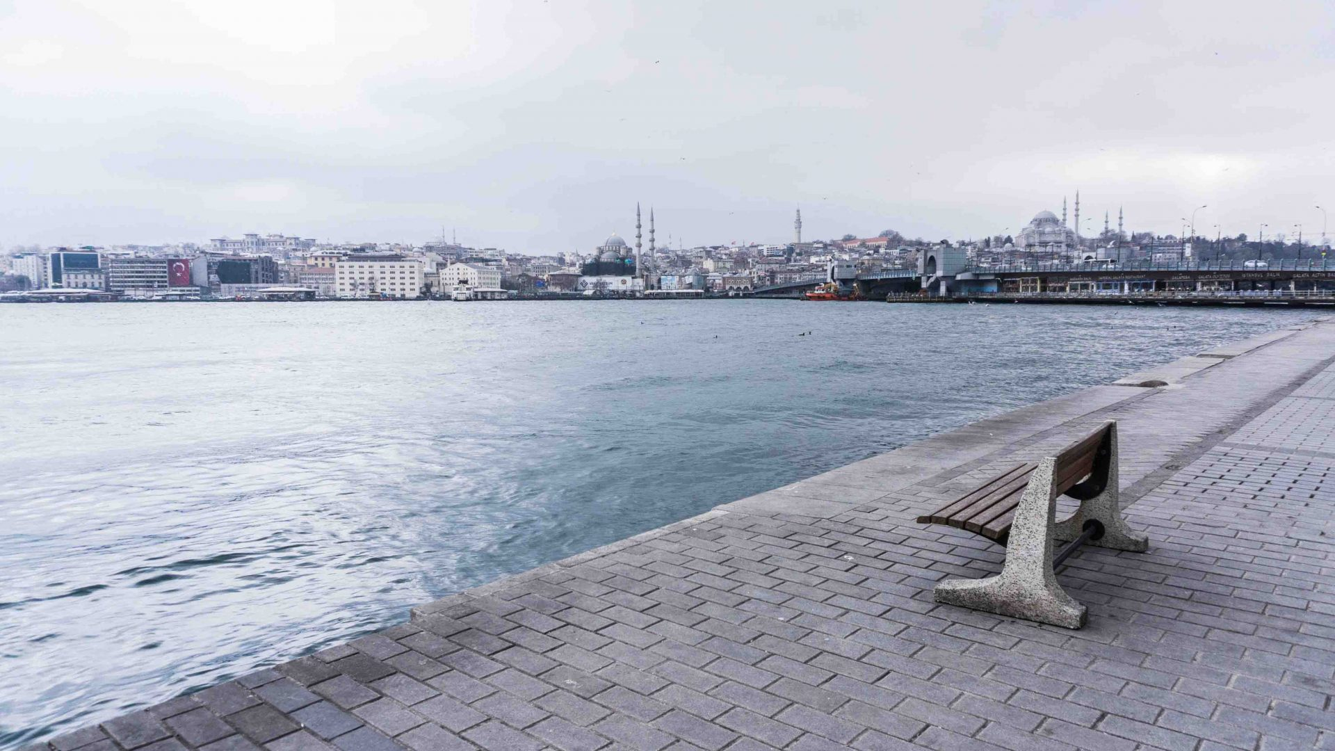 The lively harborside area of Karaköy in front of the old town, near the Galata Bridge.