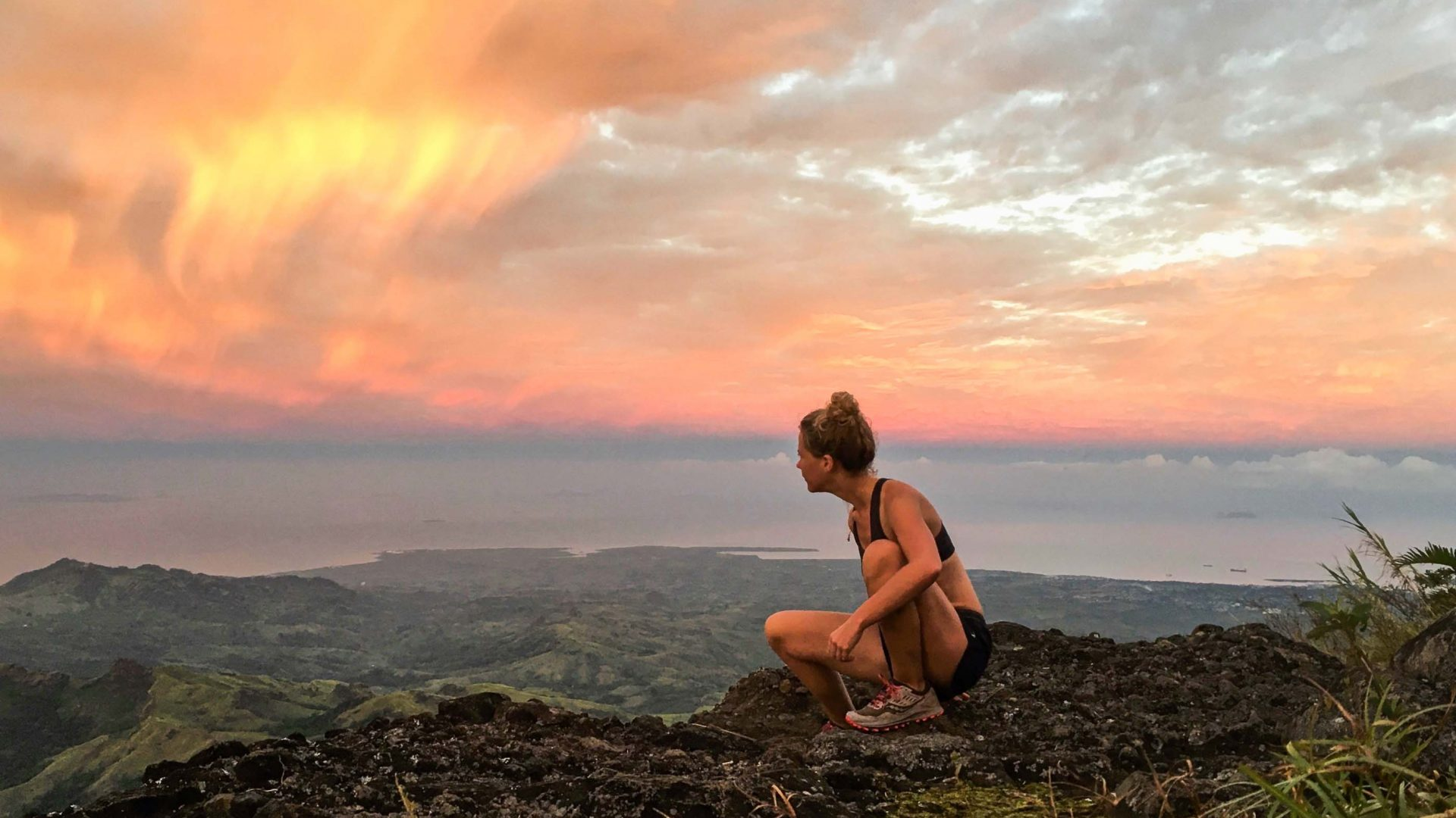 Sadie looks out at an orange sunset.