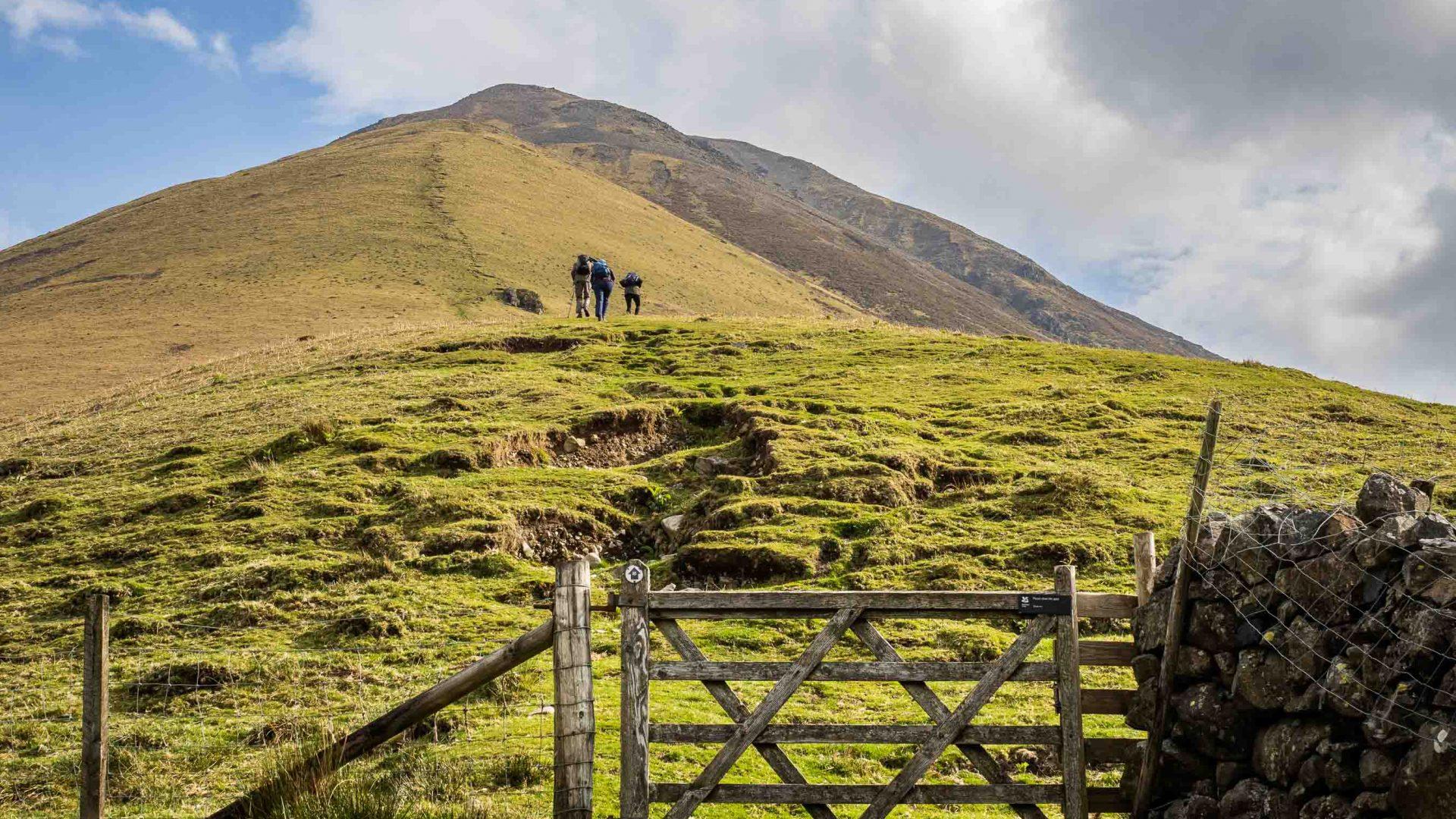 Three hikers on Kirk Fell