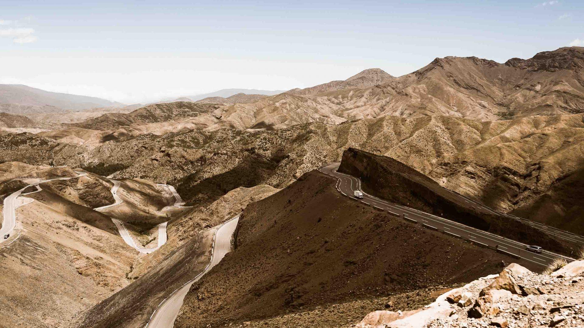 A winding road through an arid landscape.