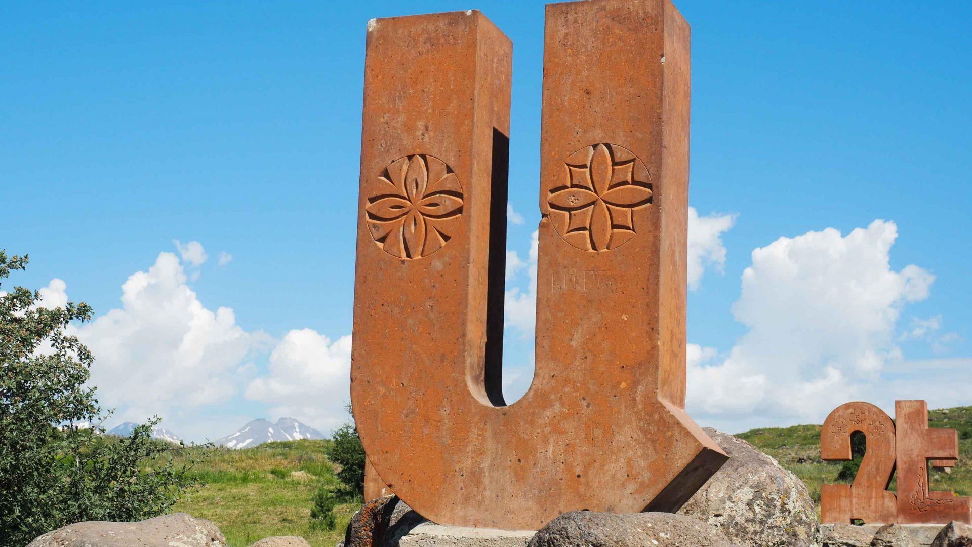 Letters of the Armenian alphabet dot the landscape.