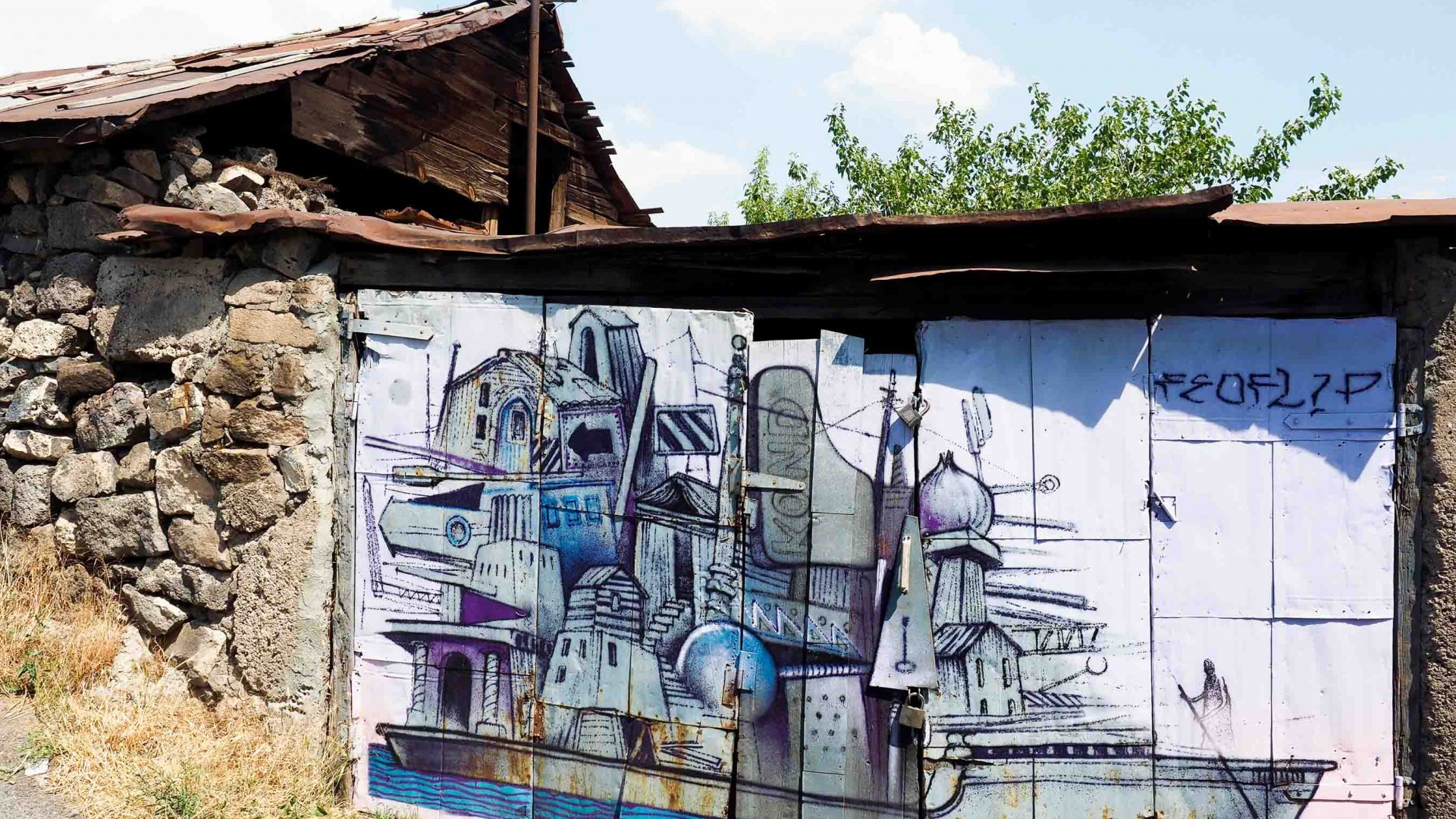 The wall of a home with street art on it.