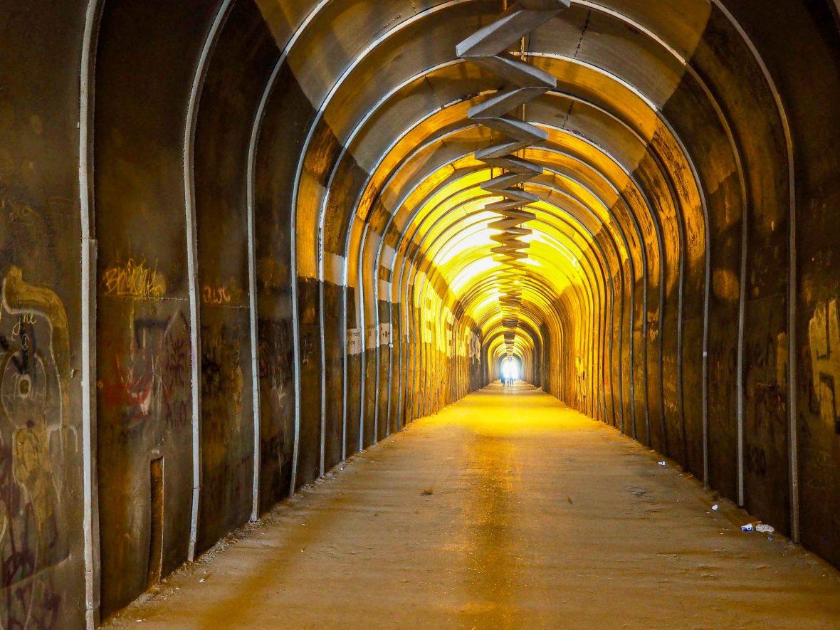 A long dimly lit tunnel.