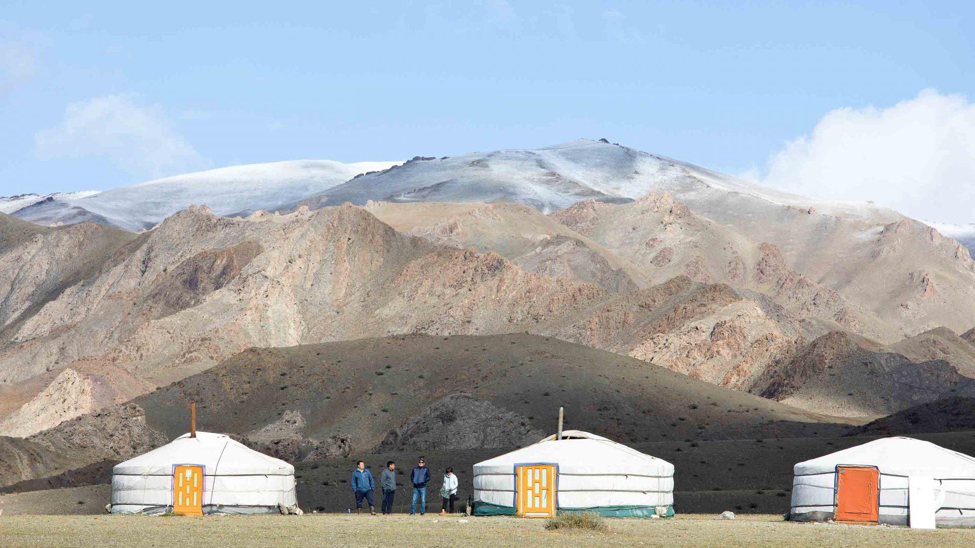Yurt shaped structures in a barren landscape.
