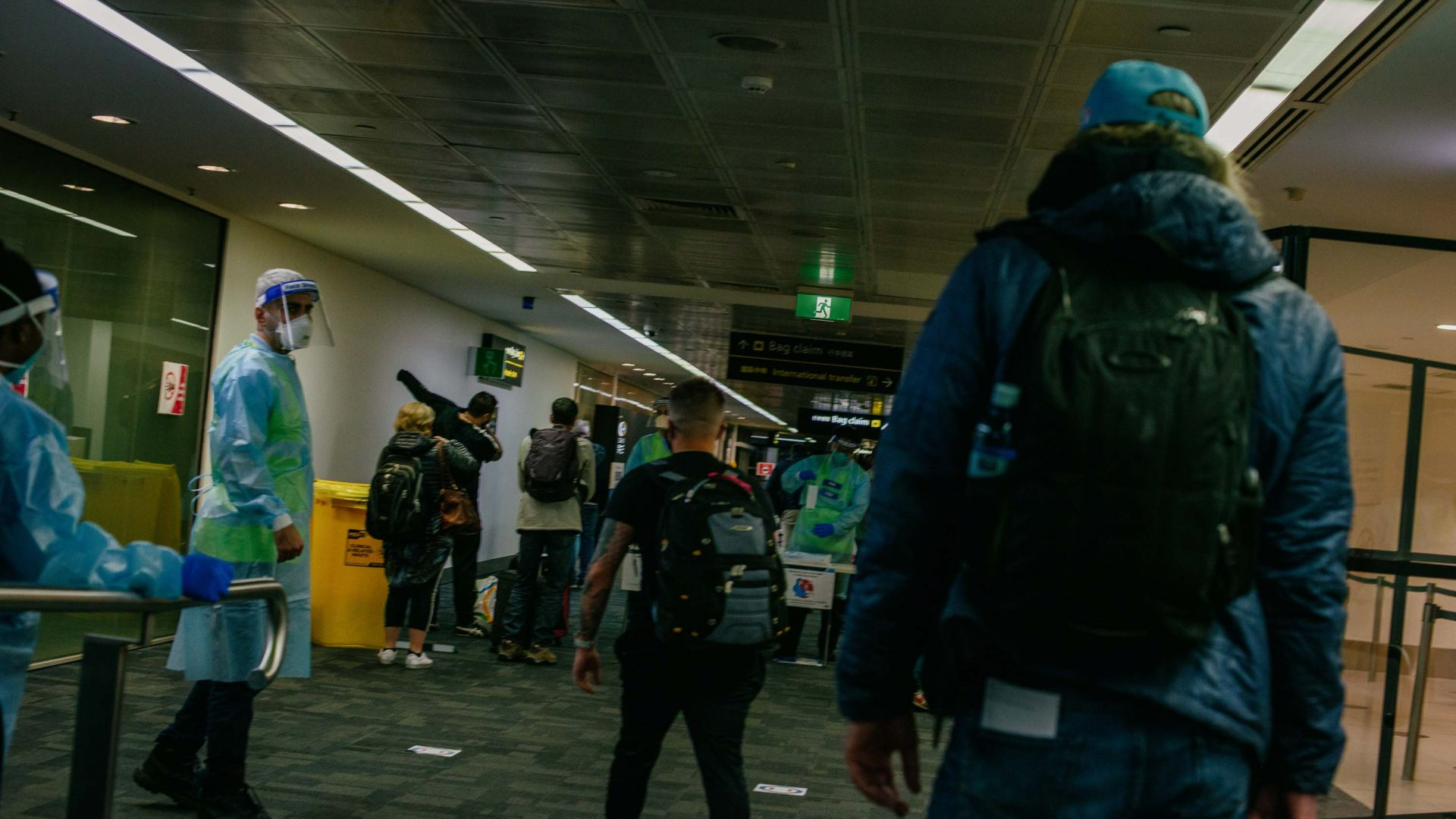 A lone passenger arrives at one of the airport checkpoints.