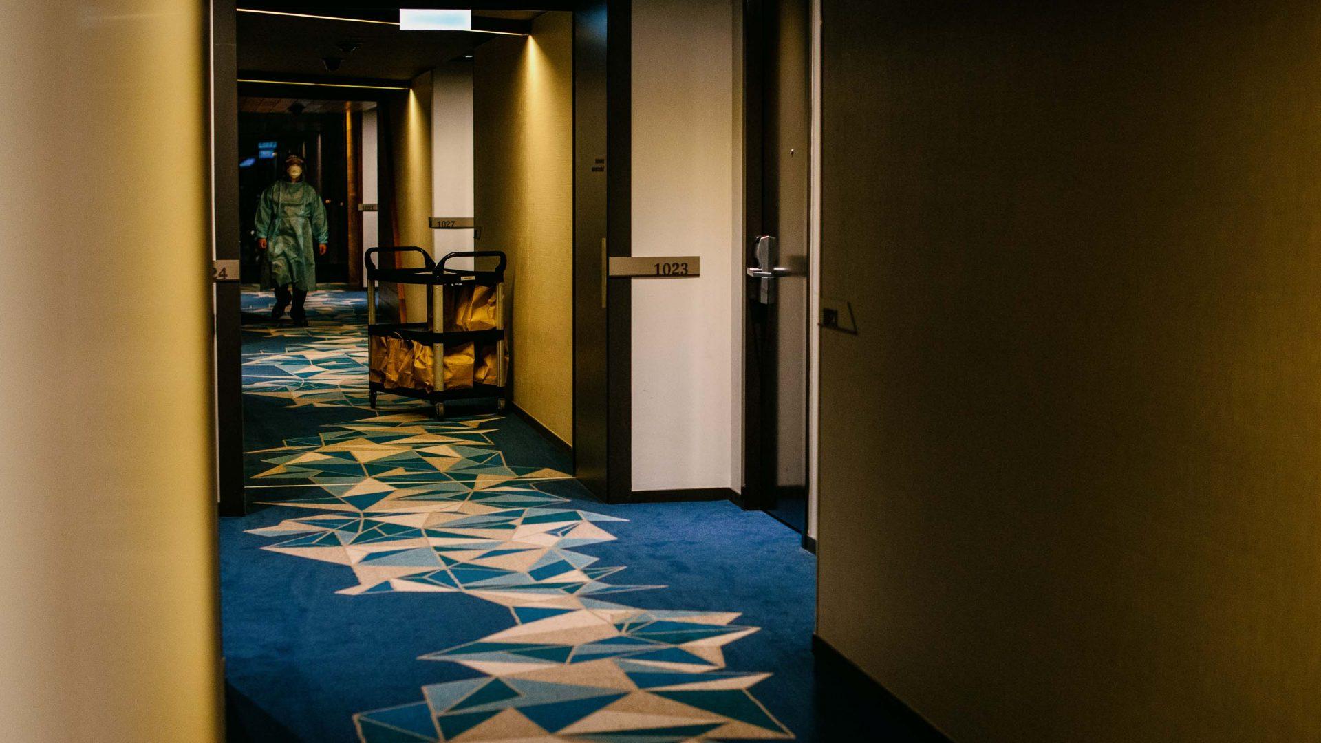 A dark hotel corridor.