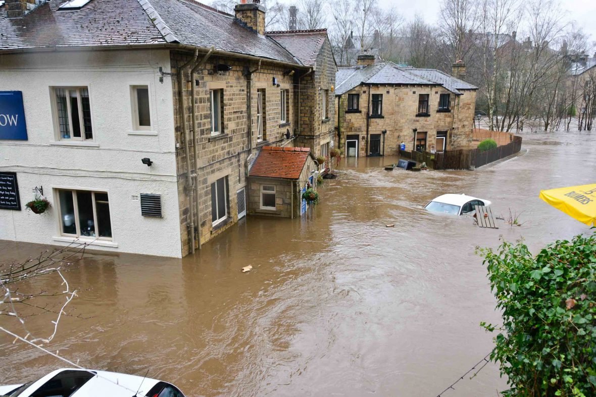 Houses and cars are underwater during a flood.